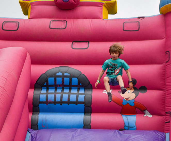 kids playing on bouncy castle